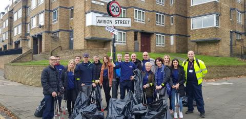 Volunteers from Avison Young clean Avison Street.
